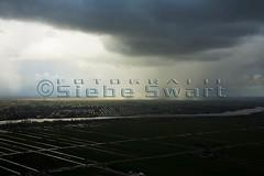 20080304_0400.jpg (Luchtfotografie SiebeSwart.nl Aerial Photography) Tags: auto water regenboog maas regen bui lek landschap waal snelweg weer wolk onweer algemeen scheepvaart milieu leegte autosnelweg binnenvaart infrastructuur dijken waterwerken wolkenlucht fijnstof klimaat autoweg wegverkeer binnevaart snelwegen luchtenwolken luchtverontreiniging ruimtelijkeordening verkeerenvervoer landschapennatuur verkeerspleinen ruimtegebruik infrastructureleprojecten swartcollectie rivierenkanaal clicheholland