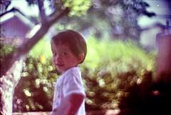 hahaha....difficult  to focus (e.y. toreno) Tags: film child 200 wideopen f095 c41 canon50mm canon7 kodakcolorplus beyondbokeh