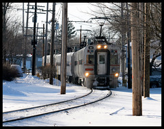 Holliday Street (Mickey B. Photography) Tags: street city railroad winter snow cold west electric digital train canon lens eos rebel nw december northwest michigan south north tracks indiana rail line telephoto shore rails css service passenger interurban dslr holliday 2010 in xti laportecounty csssb 55250mm chicagosouthshoreandsouthbendrailway