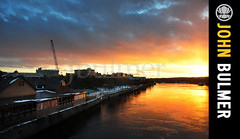 Sunset : Troy, New York : 12.16.10 (john bulmer) Tags: city bridge autumn winter sky sun newyork color reflection water skyline clouds river south troy hudson greenisland firstlightlastlight johnbulmer johnbulmerphotography