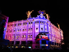 One of the spectacular joys of the Christmas Season in Curitiba! (peggyhr) Tags: pink blue windows friends brazil sky black children gold lights gallery niceshot crowd optical christmaslights loveit pa curitiba angels harmony showroom mauve soe breathtaking musictomyeyes sobeautiful 20thanniversary blueribbonwinner bugles palácioavenida topshots 25faves abigfave shieldofexcellence peggyhr flickrbronzeaward heartawards diamondstars fl♥ckrhearts artistspotlight exploreunexplored everydayissunday cherryontopphotography thebestshot flickrcuritiba ·spiritofphotography ♡beautifulshot♡ ·flickrstars 100commentgroup grouptripod artofimages angelawards dragonflyawards passionforlight arethesebuildingsnothisisart pegasusaward postthebest flickrsportal mygearandme1 ringexcellence level1photographyforrecreation level2photographyforrecreationsilverforqualifiedphotos blinkagainforinterestingimages hsbcchristmaschoral 0160a 3r1c♥navidad♥natal♥christmas♥