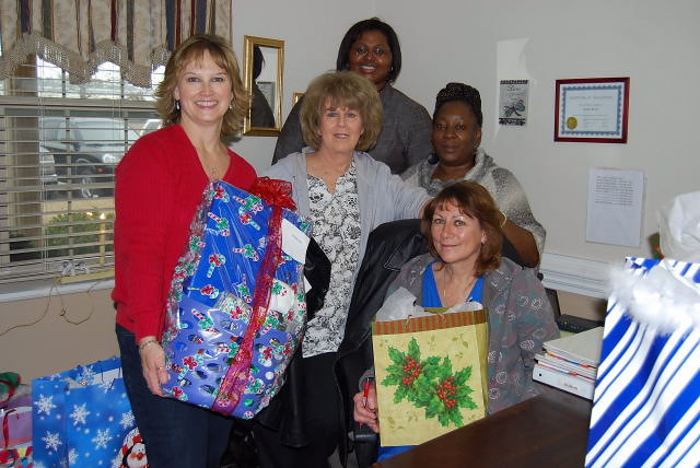 Murphy-Brown employees give back during the holidays at the Wallace Gardens assisted living facility.
