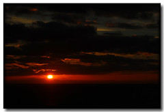 LA LUZ DE UN NUEVO AO (J.L.G.C.) Tags: sunset color sol rojo nikon paisaje amanecer cielo tenerife sanandres d90 sigma1770