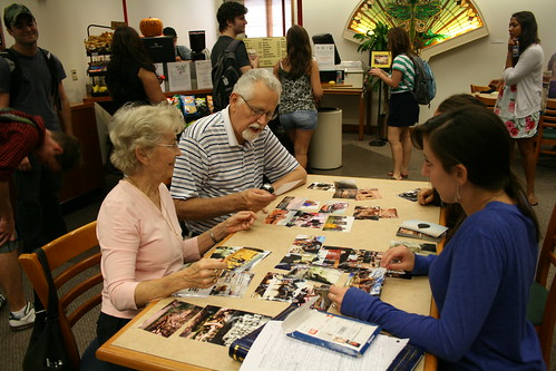 Rollins students and Mayflower residents work on their Memory Book project