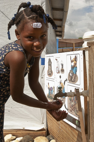 Angeline washes her hands to protect against cholera