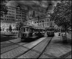 HDR Cathedral Square Trams (Pommedan (DG Images)) Tags: new city trees christchurch people bw white black dan photoshop buildings landscape lumix movement web centre canterbury panasonic zealand nz rails restuarant nik trams fz hdr goodwin sharpened photomatix colorefex silverefex fz38 fz35 pommedan
