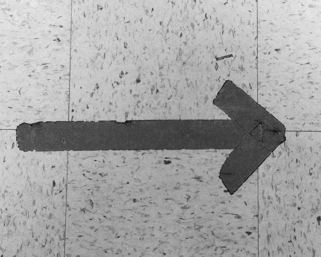 Arrow on Tile Floor
