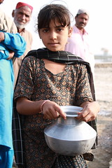 Collecting clean water in rural Sindh (DFID - UK Department for International Development) Tags: pakistan water girl flooding child development sindh floods sanitation naturaldisaster humanitarianaid ukgovernment britishgovernment departmentforinternationaldevelopment dfid overseasaid ukaid