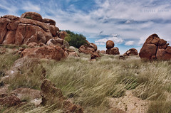 Devils Marbles (Louise Denton) Tags: red grass rock clouds rocks nt australia darwin cliffs boulders outback hdr northernterritory devilsmarbles tennantcreek stuarthighway canon450d