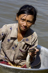 A girl and a snake in a washtub in Tonl Sap Cambodia 1 (Pondspider) Tags: lake water river children fishing cambodia vietnamese snake floating villages wash tub siemreap paddling snakes mekong sap coracle tonle anneroberts coracles sap annecattrell pondspider tonl