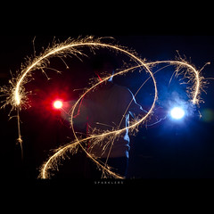 144/365 Sparklers (brandonhuang) Tags: blue light red black dark fire person long exposure streak smoke flames flash trails sparklers trail flame streaks sparkler sparks spark strobe flashes strobist strobies brandonhuang