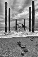 Brighton west pier ruins (JohnB's photos) Tags: induroct214 nikond610 nikon2470mm monochrome pier brighton west ruin waves pebbles rocks clouds moody dramatic