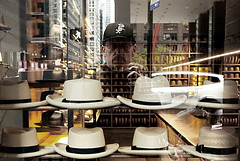 Hats (draketoulouse) Tags: loop chicago street streetphotography people portrait selfportrait color city urban whitesox shop reflection window calder flamingo