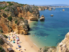 Portugal - Algarve - Lagos (Been Around) Tags: ocean sea panorama sun mer praia beach portugal strand umbrella vacances rocks meer europa europe mare waves niceshot urlaub travellers eu wave playa cliffs lagos fels algarve umbrellas sonne plage atlanticocean oceanoatlntico lido praiadocamilo 2010 felsen wellen atlantik barlavento sonnenschirm sonnenschirme 5photosaday onlyyourbestshots concordians thisphotorocks ilustrarportugal worldtrekker visipix expressyourselfaward bauimage regiodoalgarve