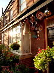 Decorations on a house on Claremont Road in Moss Side, Manchester (Alex Pepperhill) Tags: uk decorations manchester mobiles unitedkingdom creativecommons windchimes baubles claremontroad mossside commercialuse hangingbaskets forcommercialuse commercialuseallowed