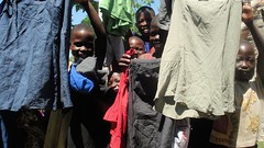 Proud of New Clothes (dreamofachild) Tags: poverty children village african poor orphan orphanage uganda humanitarian villagers eastafrica pader ugandan northernuganda kitgum humanitarianaid aidsorphans waraffected childcharity lminews
