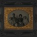[Unidentified African American soldier in Union uniform with wife and two daughters] (LOC)