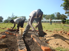 Busyubi Primary school-BWP Workers constructing well pad