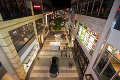 santa monica place (Eric 5D Mark III) Tags: california street light people distortion reflection night canon mall booth vanishingpoint losangeles neon santamonica perspective wideangle cadillac promenade 3rdstreet santamonicaplace ghosttrail ef1635mmf28liiusm eos5dmarkii