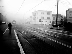 Waiting Through The Fog (SHUN [iamtekn]) Tags: sanfrancisco road street camera blackandwhite white mist black monochrome car mobile fog train day phone n muni judah sunsetdistrict iphone iphone4