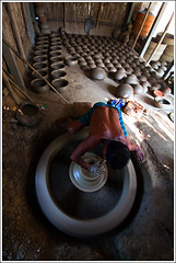 The Clay-man isn't a layman - II [..Chuadanga, Bangladesh..] (Catch the dream) Tags: light man reflection art wheel hands artist mud manatwork potter craft hut busy motionblur clay revolution pottery rotation tradition bangladesh diligence revolving artcraft revolve potterswheel cottageindustry chuadanga alamdanga ailhash craftofclay gettyimagesbangladeshq2