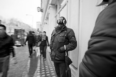 Man with Umbrella, Gas Mask (Garson Byer) Tags: leica blackwhite voigtlander oxfordstreet oxfordst voigtlander15mmf45 voigtlander15mm londonstreetphotography leicam8 leicam82 m8street blackwhiteinalonelyplace m82leicaleica