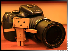"Explored:  ""Yes Danbo, It Has A Long Zoom!"" (lennox_tpc) Tags: world life camera canon lens toys eos amazing still explore finepix fujifilm dslr discovery danbo 18200mm explored 60d danboard s200exr"