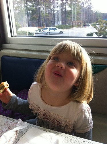 Happy girl with a mouthful of hamburger