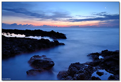 Aci Castello - The day that never comes (ciccioetneo) Tags: new sea italy seascape clouds sunrise dawn nikon rocks long exposure italia angle wide sigma filter sicily 1020mm grad brand catania sicilia graduated acitrezza cokin acicastello p121 d3100 ciccioetneo