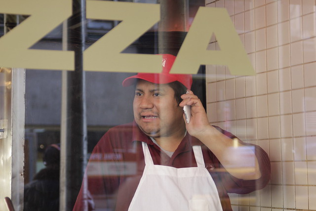 Pizza man with phone