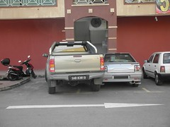 That's Too Close, I Think.. (thienzieyung) Tags: cars lines stairs truck back crazy dangerous chaos parking rear poor bad lot 4wd problem vehicles madness malaysia terrible shops kotakinabalu arrow bully mayhem sabah fail inconsiderate toyotahilux putatan thienzieyung protoniswara