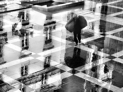 The town beneath his feet (Rui Palha) Tags: street people bw blackwhite lisbon streetphotography rainydays interestingness3 noirblanche ruipalha