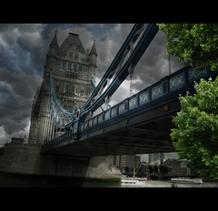 London Tower Bridge VI (Chariots_of_Artists) Tags: city bridge trees light shadow england london tower monument up stone thames architecture clouds towerbridge river boat iron view britain branches structure lookingup enbankment londontowerbridge platinumheartaward tripleniceshot flickrstruereflectionexcellence 4timesasnice 5timesasnice