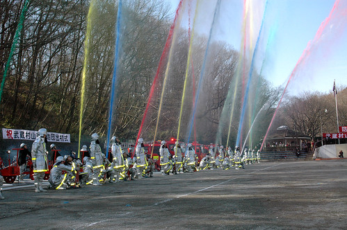 Musahinoyamamurashi Fire Brigade spraying colored water for effect