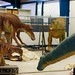 Getting the dinosaur animatronics ready for Explore-a-saurus exhibition at Scienceworks
