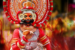 Theyyam at Kerala - The Gods Ask the Question ? (Anoop Negi) Tags: carnival red portrait india ink photography for photo dance media paint image photos delhi indian bangalore performance creative culture fair kerala dancer images brush best po carnaval ritual form mumbai anoop rites negi dissolve theyyam photosof ezee123 attachamayam bestphotographer imagesof anoopnegi jjournalism