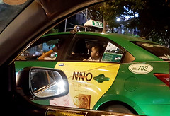 Keen to see (Roving I) Tags: curiosity taxis cabs boys children faces transport street danang vietnam