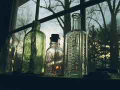 glass bottles (marissa elkind) Tags: old sunset sky window glass silhouette vintage bottles antique glassbottles vintageglass
