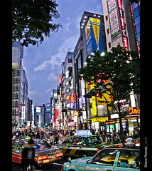 Urban Tokyo (Steve Rosset) Tags: street city wild sky people urban signs color cars japan vertical retail architecture modern shopping geotagged asian lights tokyo design crazy movement twilight asia downtown neon purple traffic vibrant cab taxi may restaurants 2006 sidewalk podium rush hour signage shops nightlife crowds active dense verticality steverosset