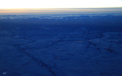 Snowy Fields, Rockies, Highwood River & Longview at Dusk (zeesstof) Tags: zeesstof canon7d canon18135is snow mountains rockies sunset streetlights longview santaseyeview windowseat aerial alberta canada