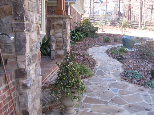 flagstone sidewalk and stone columns viewed from porch on a home in southwest Raleigh, North Carolina