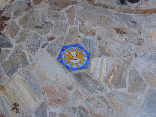 view of glass and tile sunburst set into the flagstone walkway on a home in southwest Raleigh, North Carolina