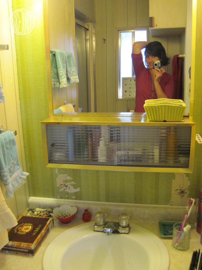 my yellow florescent lit bathroom