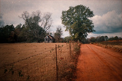 Rural Valhalla (evanleavitt) Tags: road county red abandoned film beautiful analog rural america 35mm ga georgia landscape store nikon decay south country scene southern clay fm10 laurens the