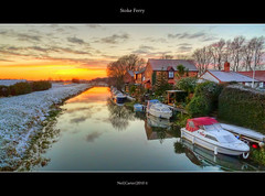 Stoke Ferry Sunset (Mr Instructor) Tags: uk trees houses sunset sky water grass ferry clouds reflections boats norfolk east panasonic adobe stoke hdr anglia photomatix tonemapped lx5 cs5 specialshotswelltaken