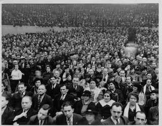 A large crowd gathers [at Madison Square Garden?] during the 1933 New York Dressmakers Strike.  A sign in the background reads: