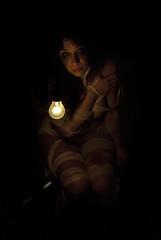 please wait... (Emanuele Tagliaferri) Tags: light portrait woman art girl beautiful night project dark nikon solitude noir alone please contemporaryart wait conceptual nikkor ritratto lux nero luce ragazza attesa lampadina bende fasce disperazione pleasewait d80 1870dx lucem nikond80