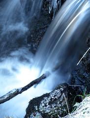 Waterfall (jkh-photography) Tags: blue white colour water rural speed river flow waterfall rocks branch slow shutter streaks soe digitalcameraclub flickraward hairygitselite mygearandmepremium mygearandmebronze mygearandmesilver mygearandmegold ringexcellence fujifilmfinepixhs10hs11