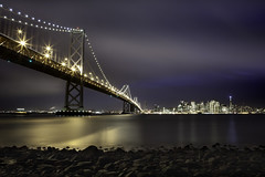 Cynosure (maxxsmart) Tags: sanfrancisco california christmas longexposure winter sunset water skyline reflections landscape lights bay rocks december cityscape cables lucky baybridge bayarea lowtide transamerica 2009 waterscape bayscape canon5dmarkii ef2470f28lusmlee6hardedgendgrad