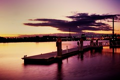 pontoon sunset (mugley) Tags: city longexposure sunset sky urban orange film water silhouette night clouds marina river lights evening twilight fuji shadows purple minolta horizon australia melbourne slide victoria scan chrome transparency yarra epson pointandshoot docklands konica positive pylons e6 pontoon urbanlandscape sensia boltebridge citylink sensia100 v700 fujisensiaii100ra freedomzoom160 rivazoom160 minoltafreedomzoom160